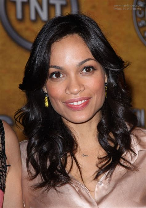 Rosario Dawson wearing her hair down and past her shoulders