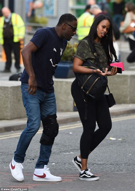 Idris Elba in playboy t-shirt spotted with mystery woman